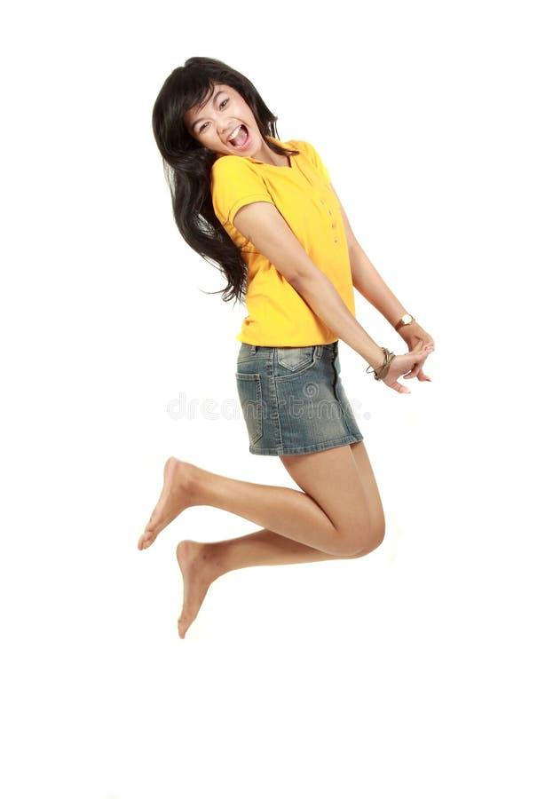 Salto bonito da menina foto de stock