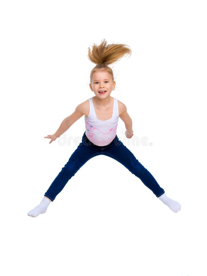 Salto da ginasta da menina foto de stock
