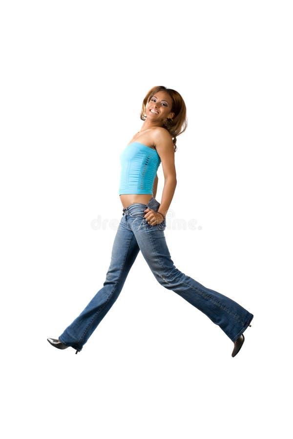 Salto da mulher do divertimento fotos de stock