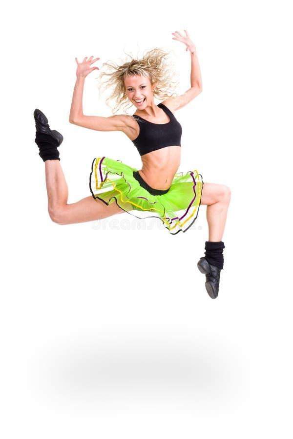 Salto de la mujer de la aptitud de la alegría foto de archivo