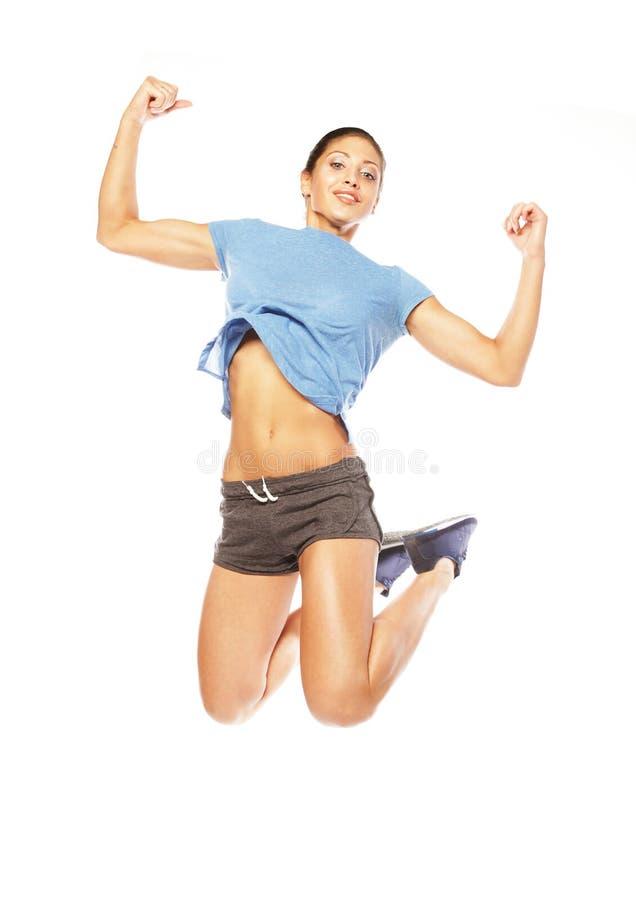 Salto de la mujer de la aptitud de la alegría. imagen de archivo libre de regalías