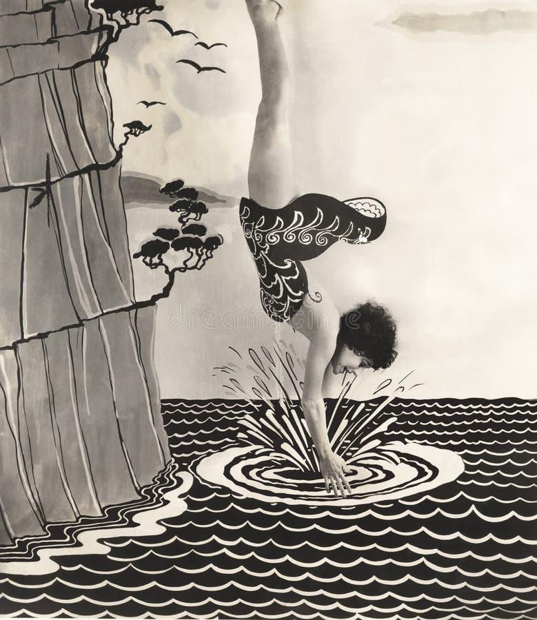 Salto de la mujer joven en el ejemplo del agua imágenes de archivo libres de regalías