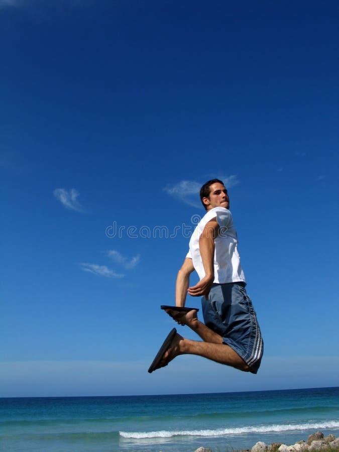 Salto de la playa foto de archivo libre de regalías