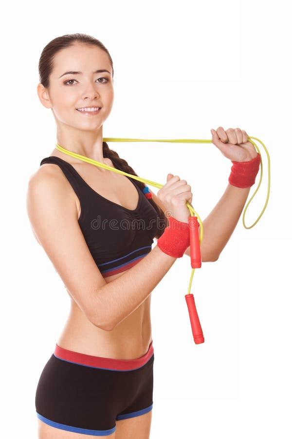 Salto della corda della tenuta della donna fotografia stock