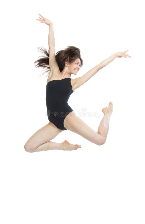 Salto do dançarino de bailado da mulher do estilo contemporâneo imagens de stock royalty free