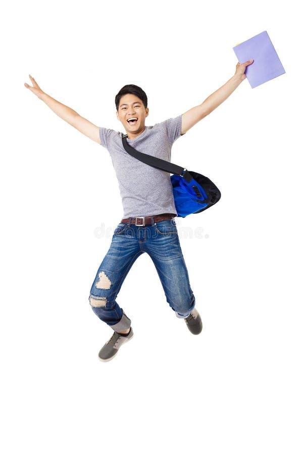 Salto do estudante do homem novo imagem de stock