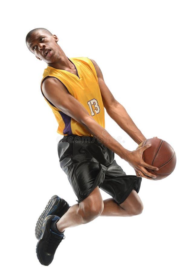Salto do jogador de basquetebol fotografia de stock