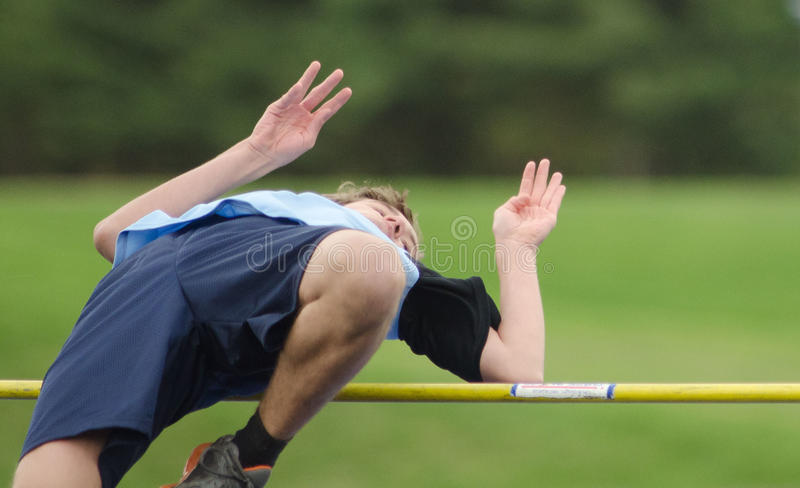 Salto elevado da trilha da High School foto de stock