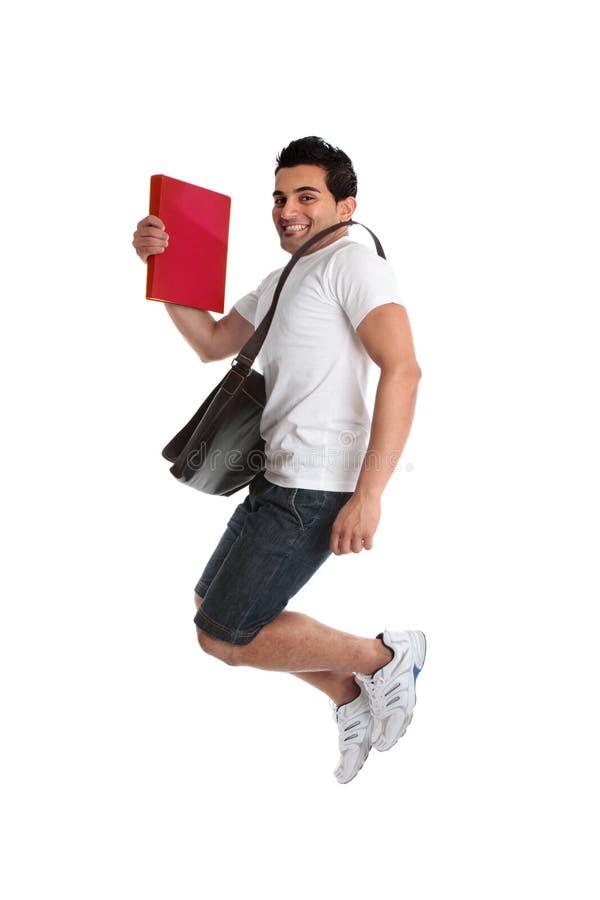 Salto emocionado del estudiante del hombre fotografía de archivo libre de regalías