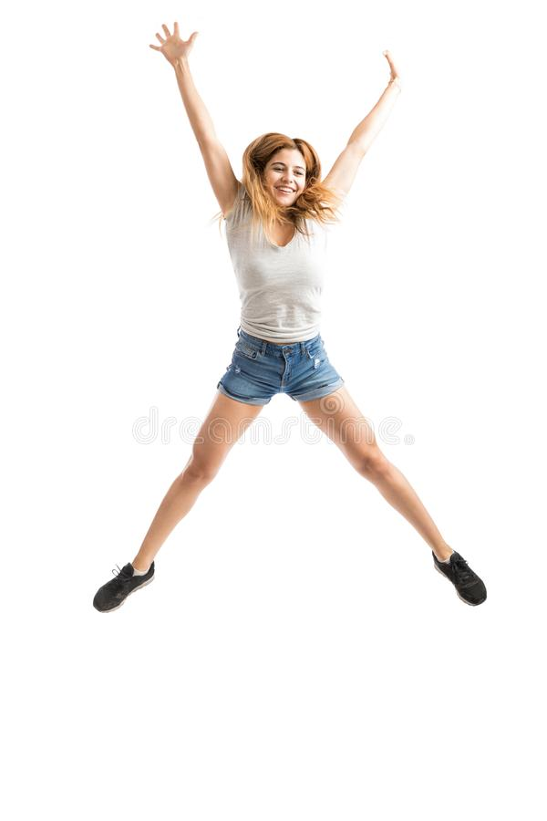 Salto Excited da mulher foto de stock