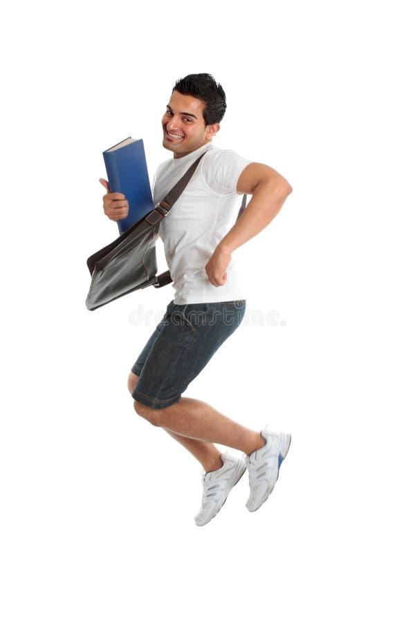 Salto Excited do estudante universitário imagens de stock