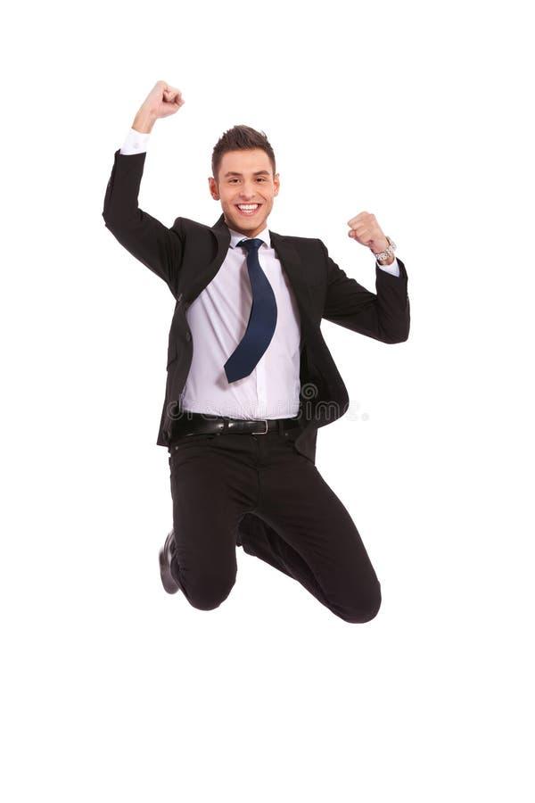 Salto extremadamente emocionado del hombre de negocios imagenes de archivo