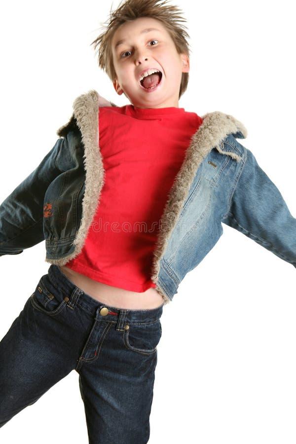Salto exuberante da criança imagem de stock