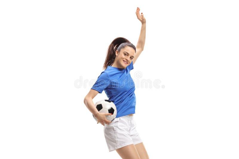 Salto fêmea do jogador de futebol imagens de stock royalty free