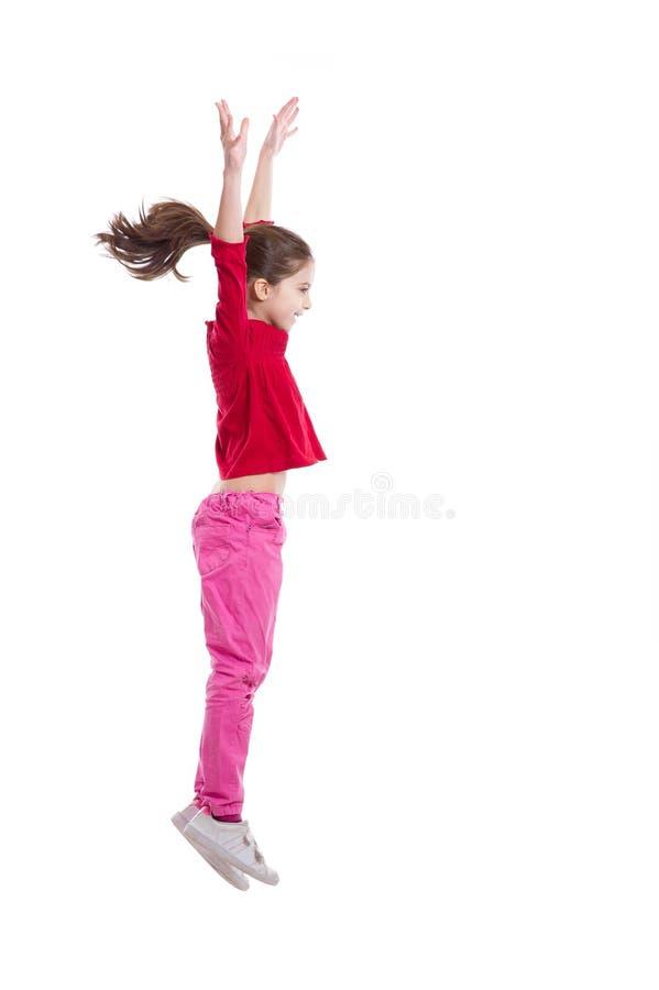 Salto feliz da menina fotografia de stock royalty free