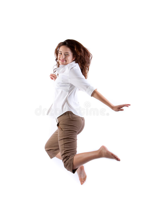 Salto feliz da mulher fotos de stock