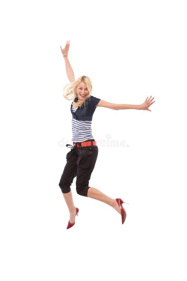 Salto feliz da mulher imagem de stock