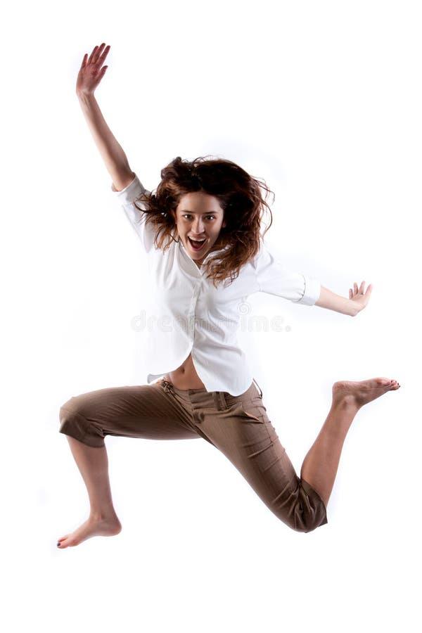 Salto feliz da mulher fotografia de stock