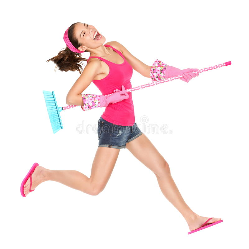 Salto feliz da mulher de limpeza fotografia de stock royalty free