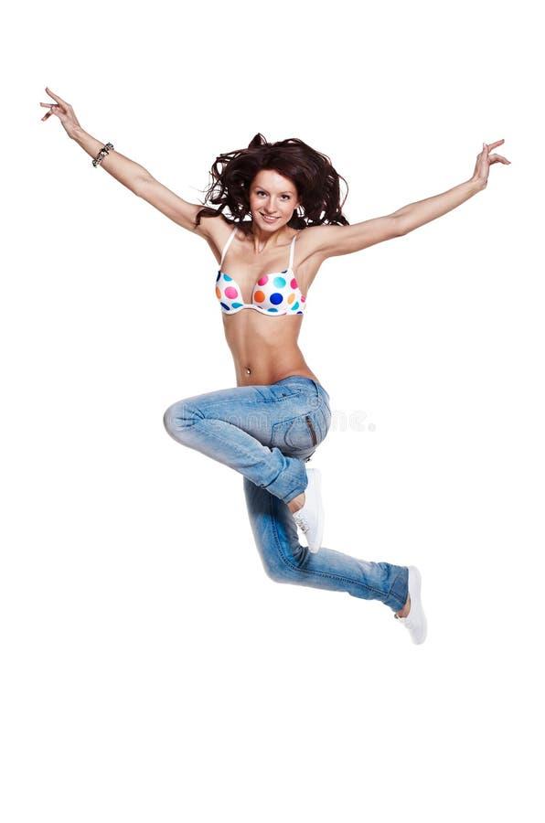 Salto feliz de la chica joven foto de archivo libre de regalías