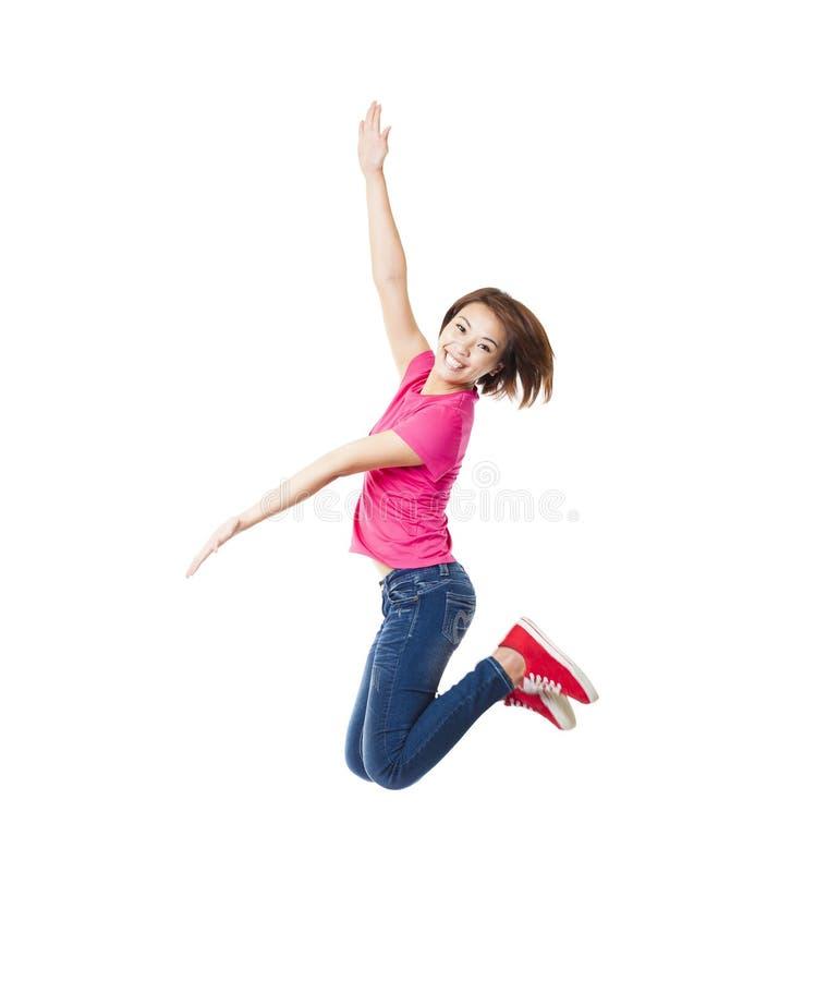salto feliz de la mujer y del estudiante fotos de archivo