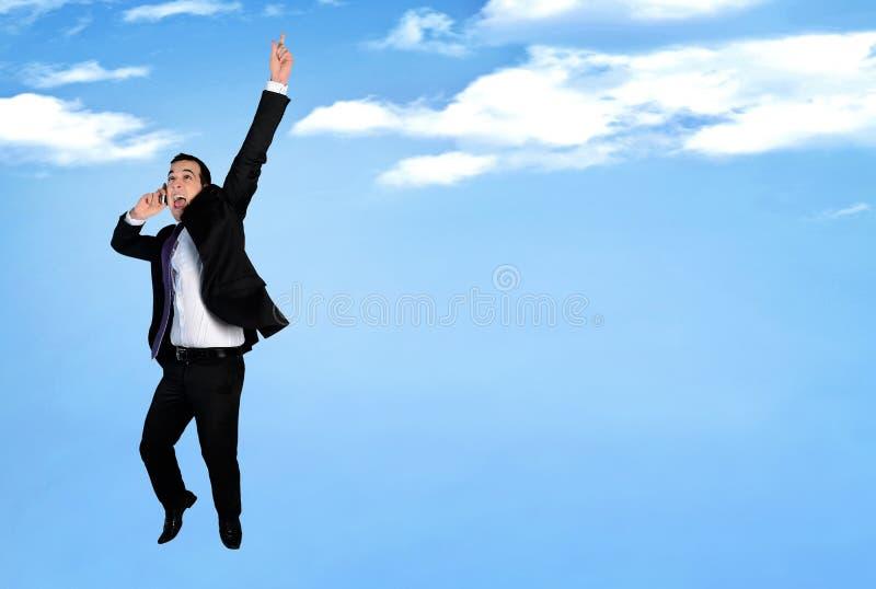 Salto feliz del hombre de negocios imágenes de archivo libres de regalías