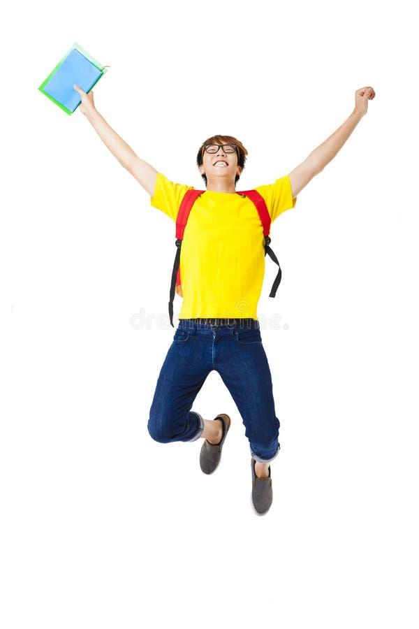 salto feliz do estudante do homem foto de stock royalty free