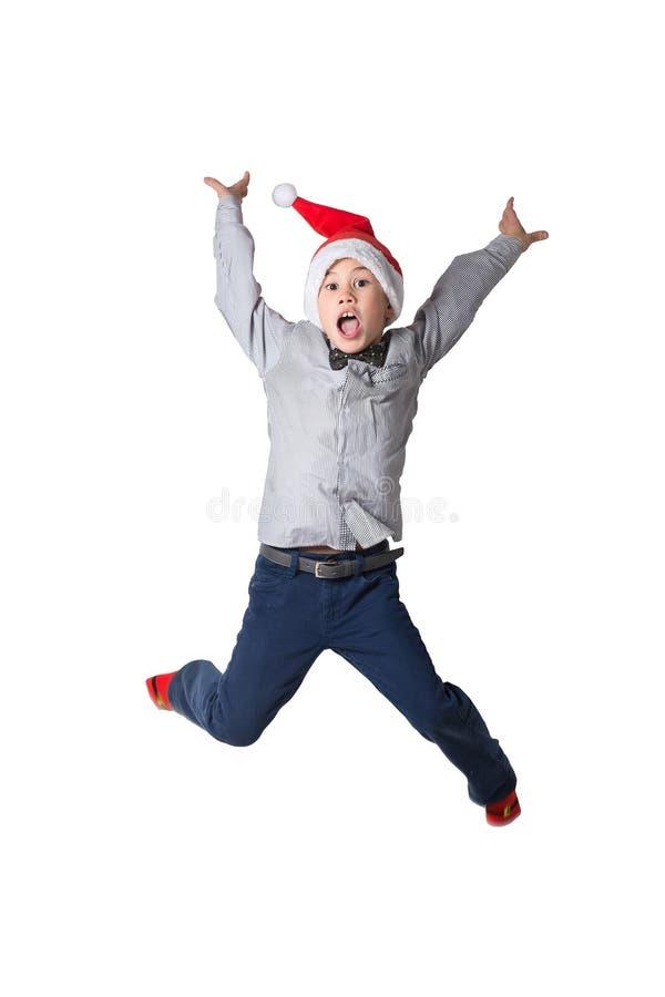 Salto feliz do menino foto de stock