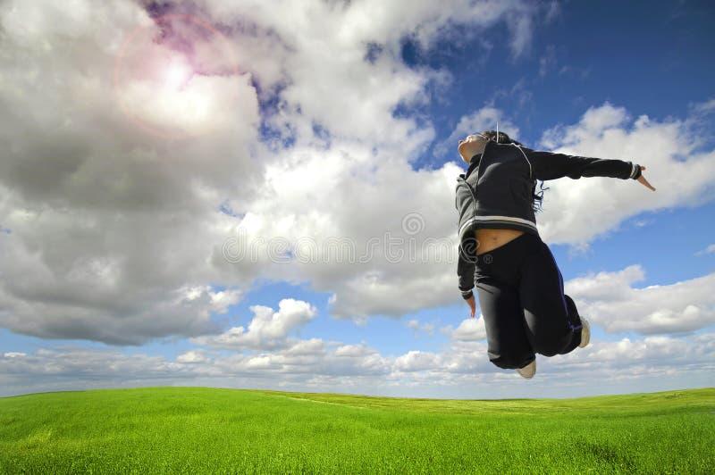 Salto feliz grande imagen de archivo