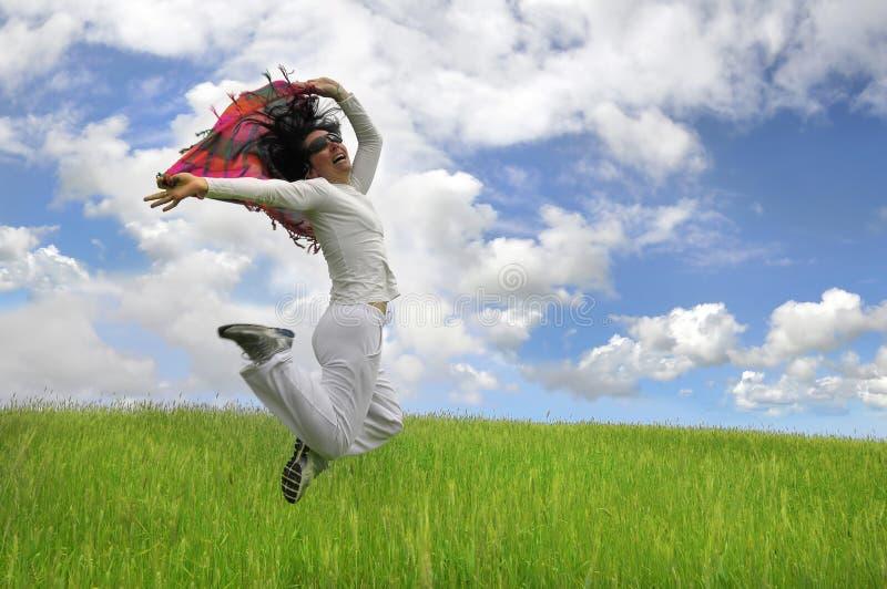 Salto feliz grande foto de archivo