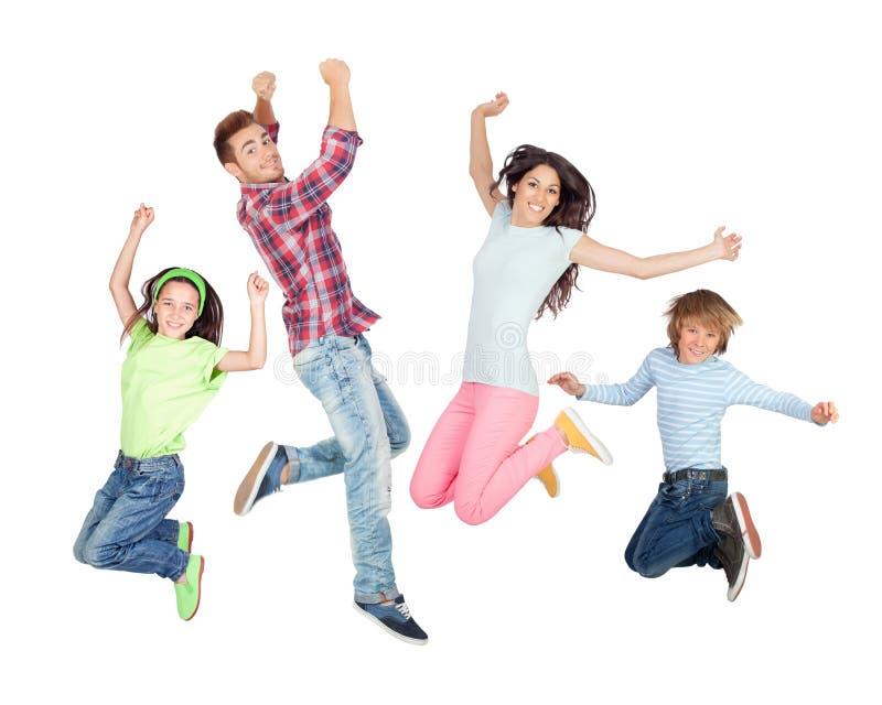 Salto feliz joven de la familia foto de archivo