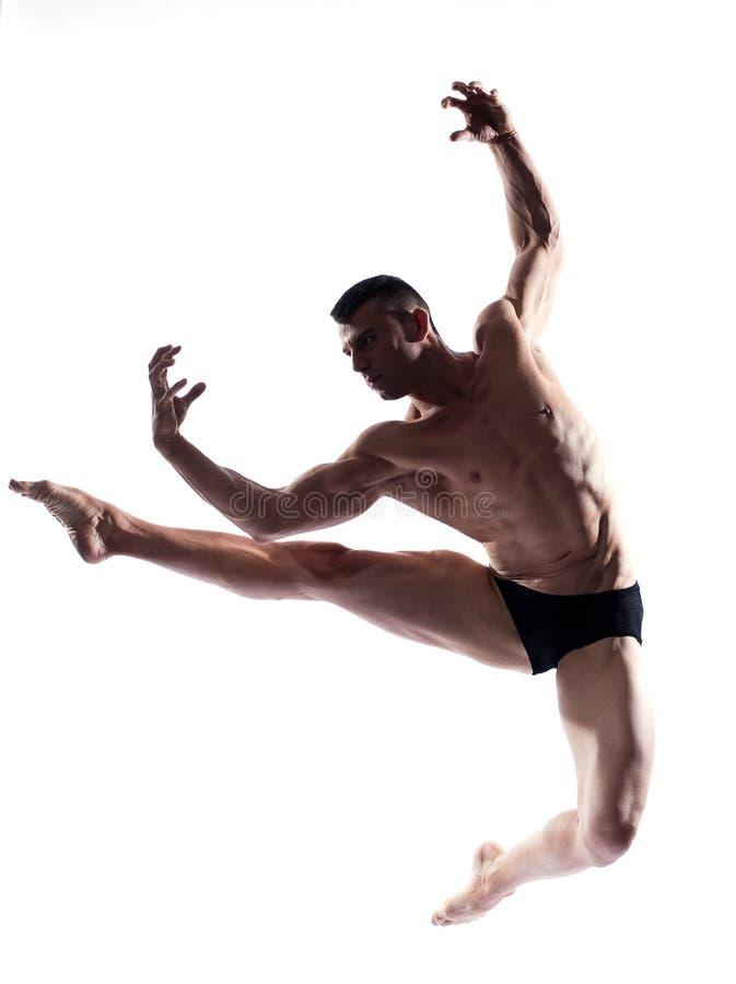 Salto ginástico do dançarino do homem imagem de stock royalty free