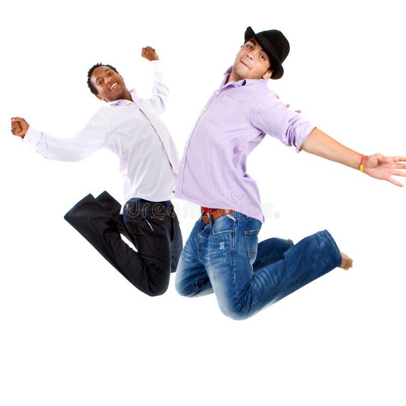 Salto inter-racial novo dos adolescentes fotografia de stock