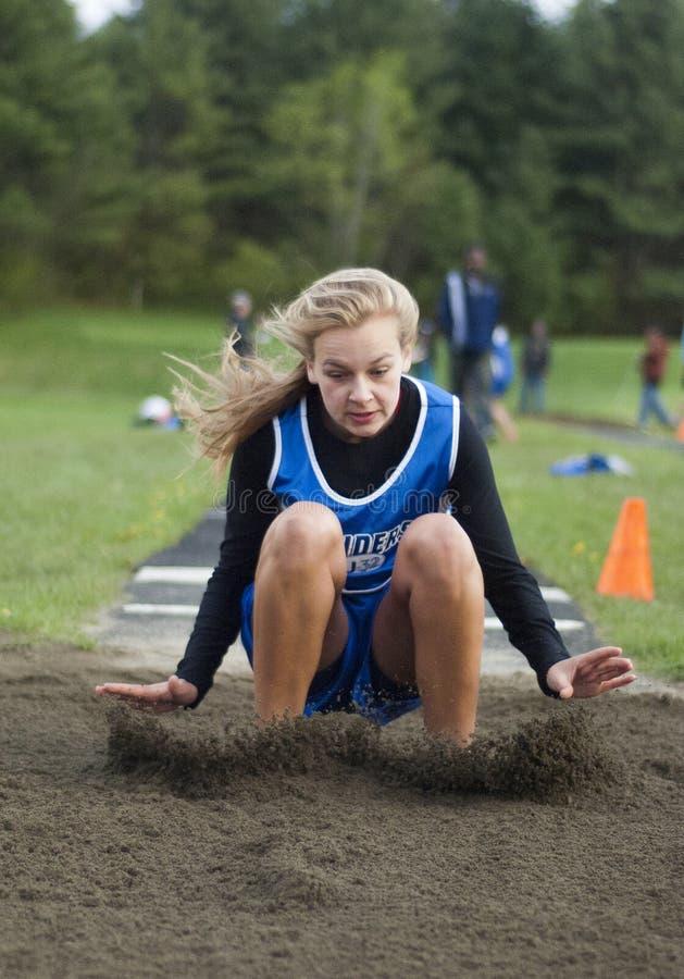Salto longo da trilha da High School fotografia de stock