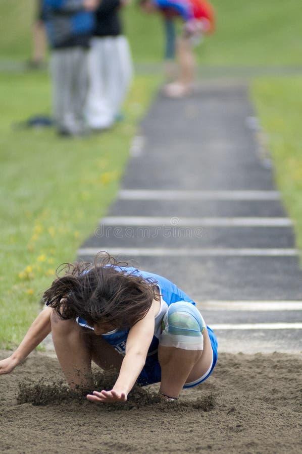 Salto lungo della pista della High School fotografie stock libere da diritti
