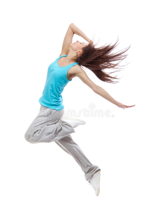Salto magro consideravelmente moderno novo do adolescente do dançarino do estilo do hip-hop foto de stock