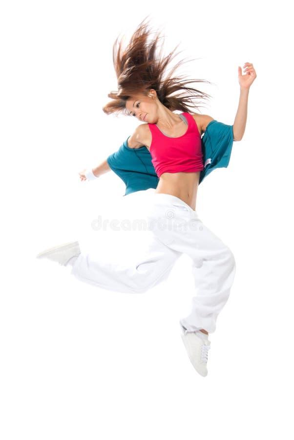 Salto magro do dançarino da mulher do estilo de hip-hop fotos de stock