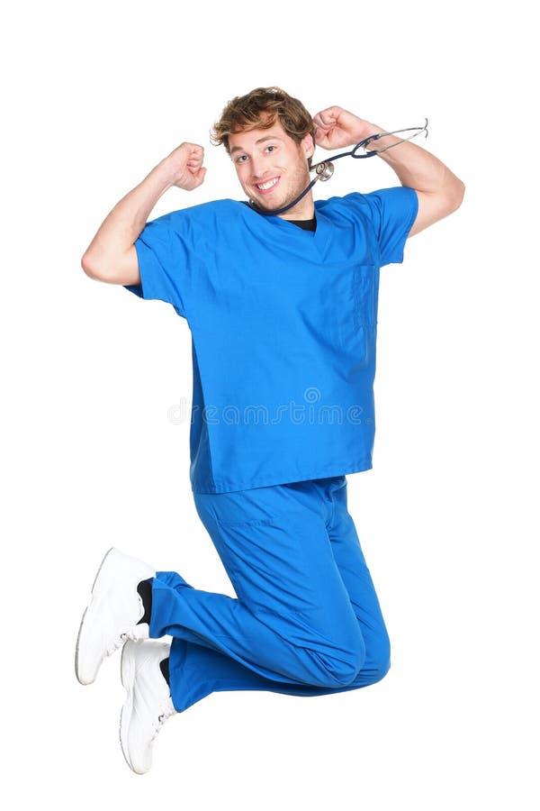 Salto masculino feliz de la enfermera/del doctor imagen de archivo libre de regalías