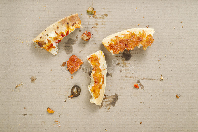 Salto restante da crosta da pizza foto de stock royalty free