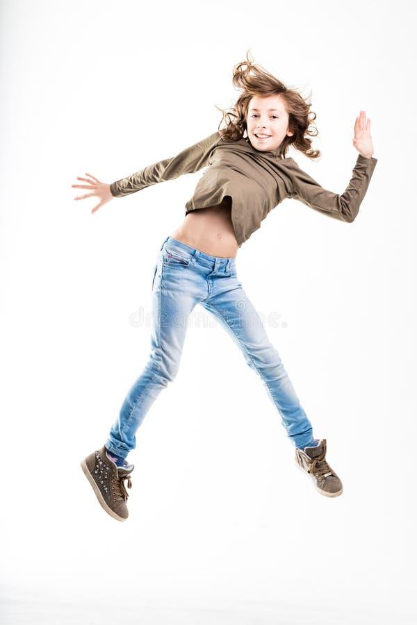 Salto sano de la chica joven foto de archivo libre de regalías