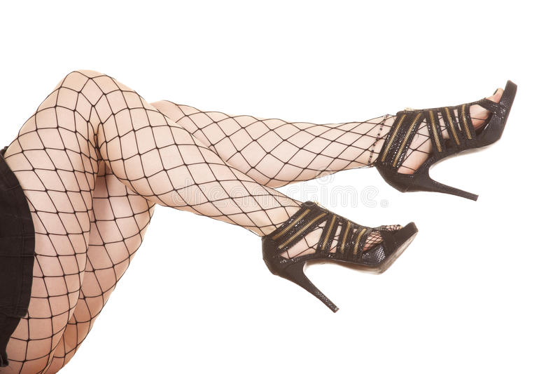 Saltos líquidos dos pés da mulher para fora imagem de stock
