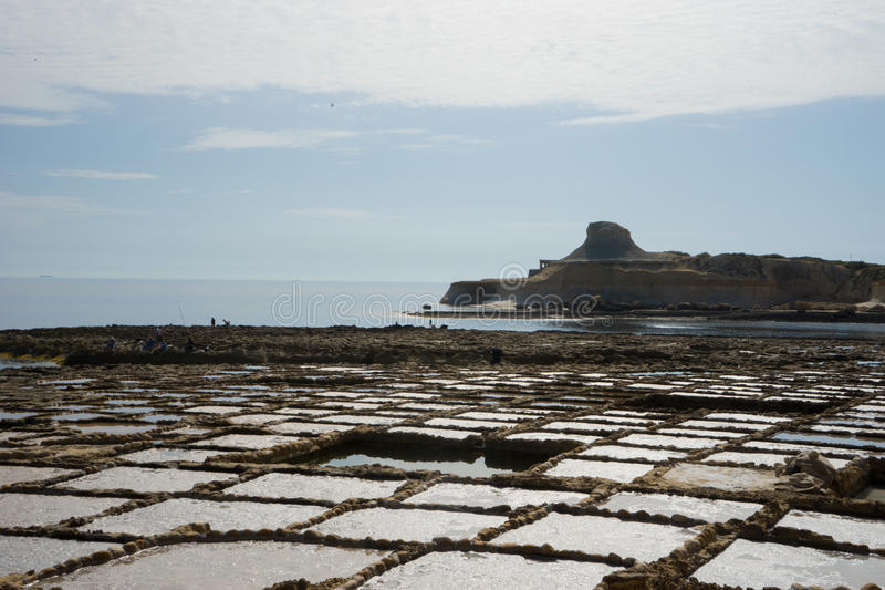 Saltpans. Rock-cut salt pans are to be found in numerous parts of the coast of the Maltese Islands, but the biggest concentration of them are undoubtedly found stock photography