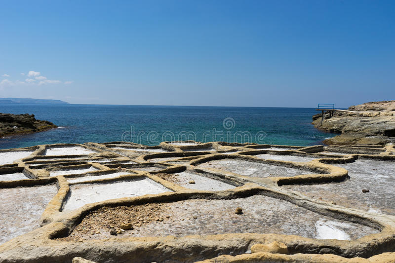 Saltpans. Rock-cut salt pans are to be found in numerous parts of the coast of the Maltese Islands, like thse, to be found in Xatt l-Ahmar, Għajnsielem, that' royalty free stock photo