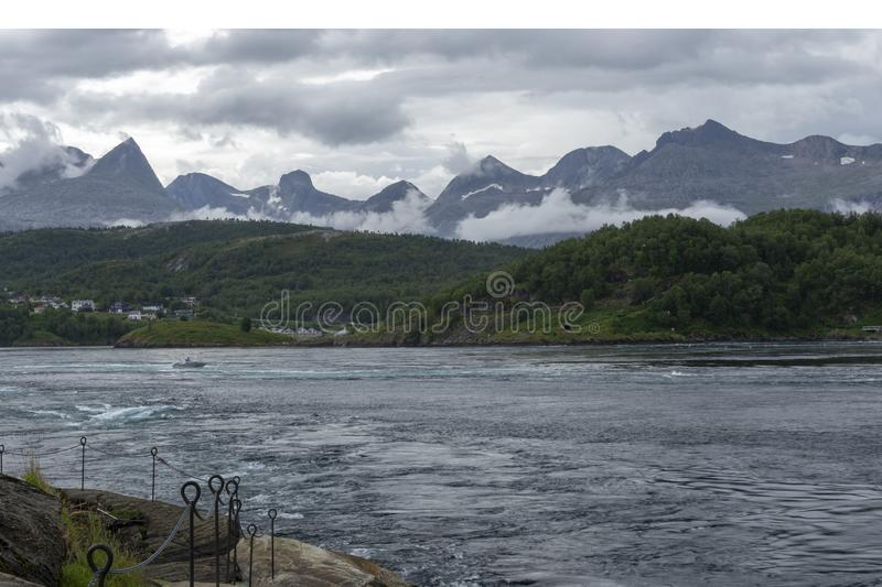 Saltstraumen tidal current in Norway with mountains in background. View to the South over Saltstraumen one of the strongest tidal current in the world with B royalty free stock photography