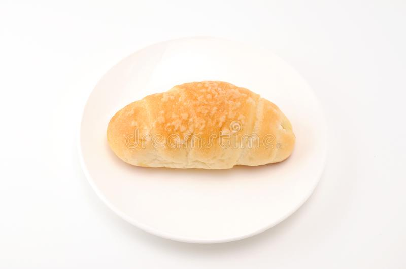 Salty butter roll bread on plate on white background. Salty butter roll bread on plate isolated on white background stock images