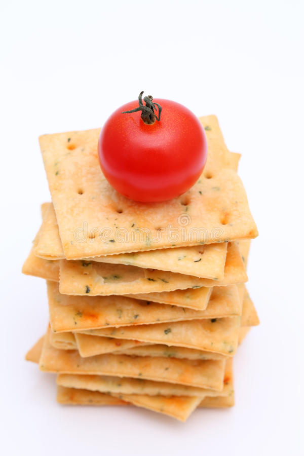 Salty crackers with tomato stock photos