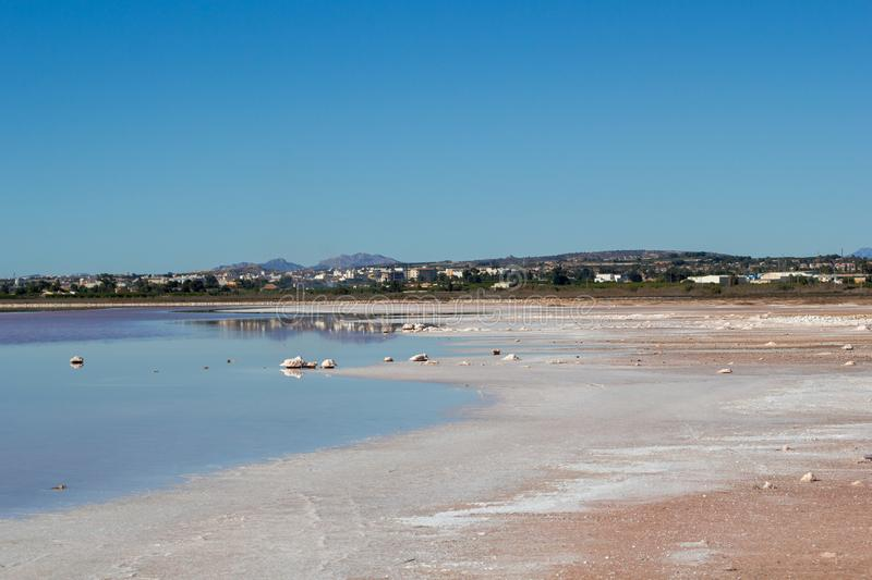 Salty lake coast landscape in shiny day. Salty lake landscape in shiny day, autumn in Spain, Torrevieja stock photography