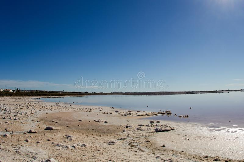 Salty lake landscape in shiny day. Salty lake peaceful landscape in shiny day, autumn in Spain, Torrevieja. Salinas royalty free stock images