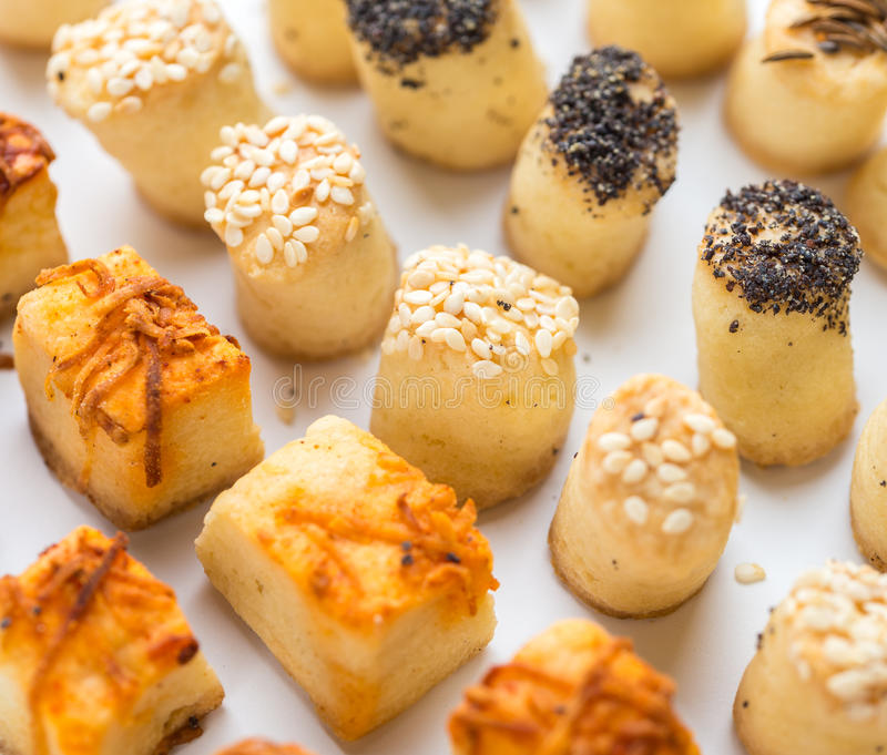 Salty party snacks stands in a row. Closeup details. royalty free stock photos
