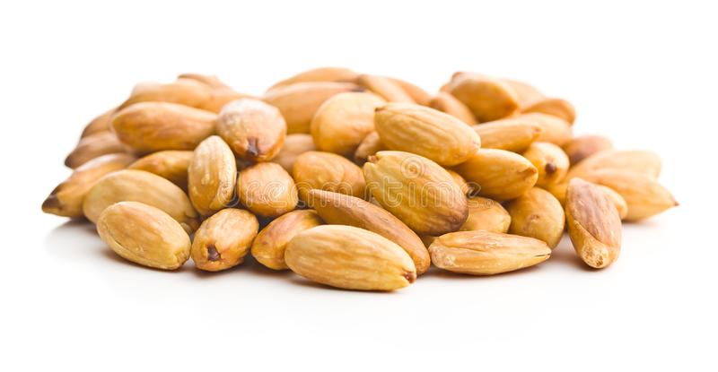 Salty roasted almonds. Isolated on white background stock images